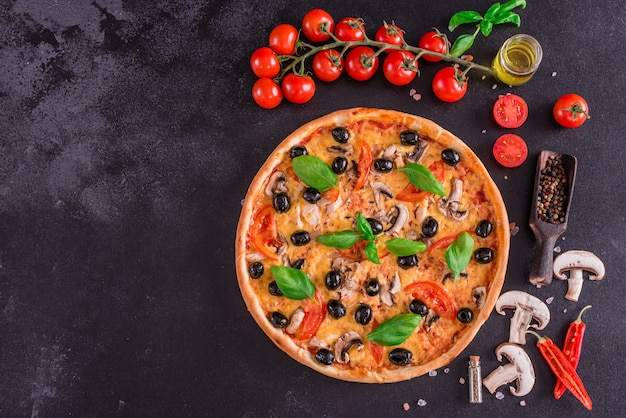 Tasty fresh hot pizza against a dark background