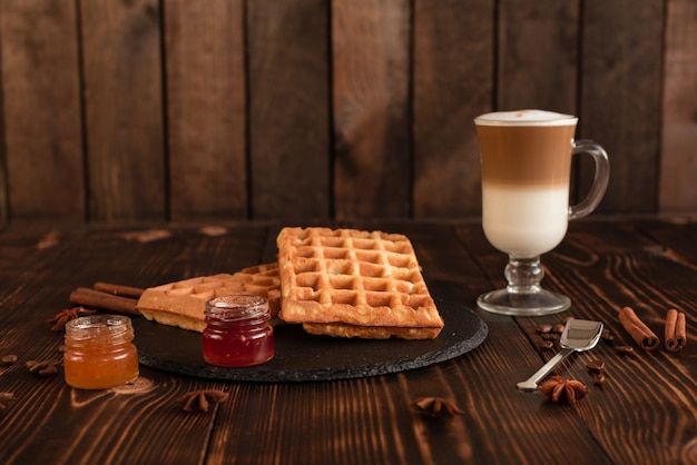 Tasty fresh vienna wafers, jam and cup of coffee