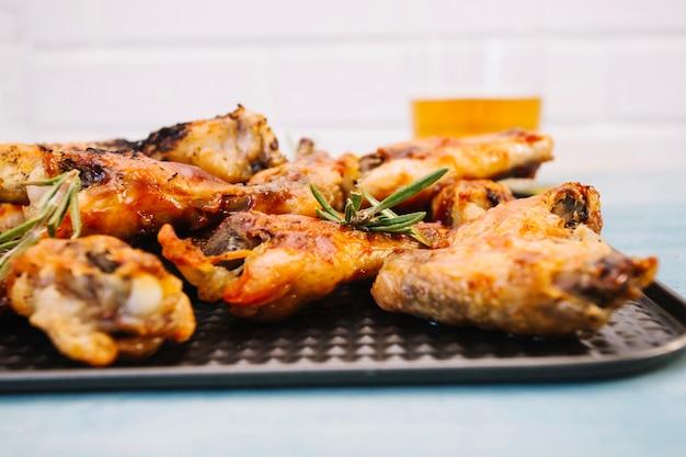 Tasty fried wings on tray