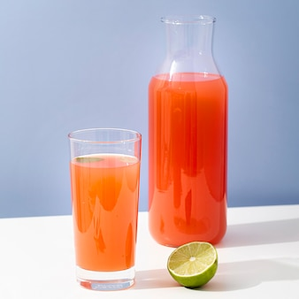 Tasty fruit juice with half lime