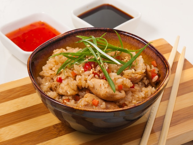 Tasty garlic rice with chicken asian cuisine