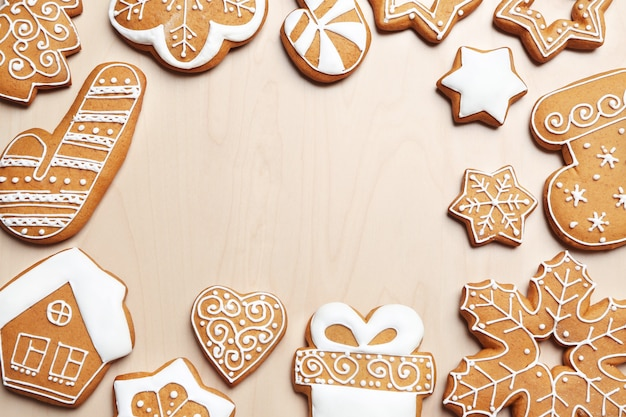 Tasty gingerbread cookies on wooden surface