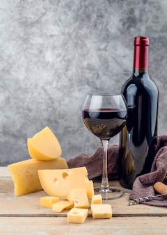 Tasty glass of red wine with mature cheese