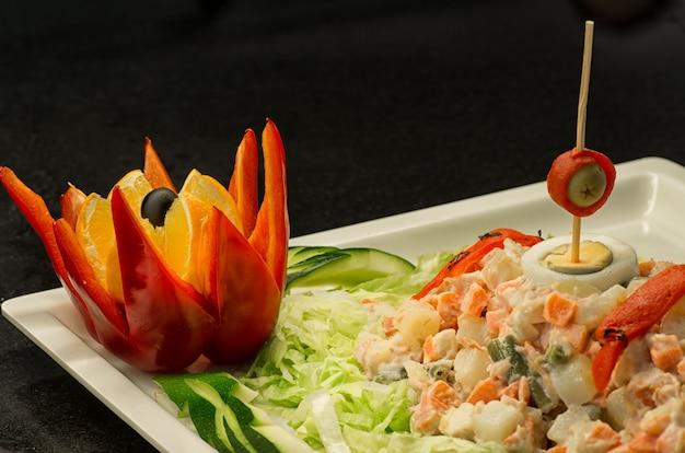 Tasty green salad of macedonia with seafood and pink sauce.