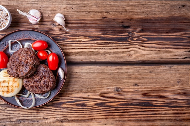 Tasty grilled burger meat with vegetables