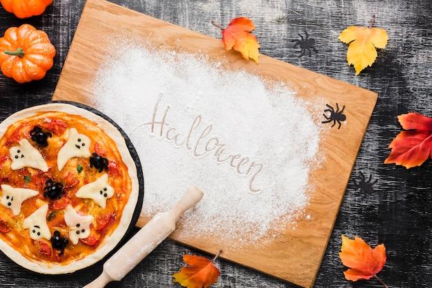 Tasty halloween pizza on wooden board