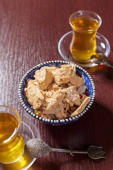 Tasty halva with tea on the table