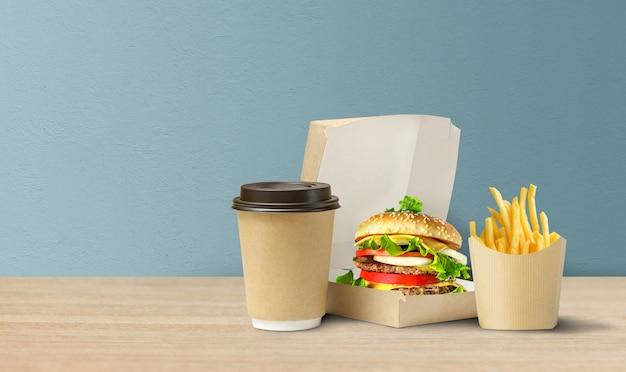 골판지 테이크 아웃 포장에 맛있는 햄버거, 감자 튀김, 커피.