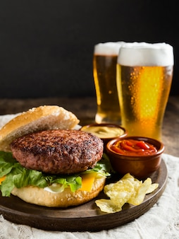 Tasty hamburger with glasses of beer