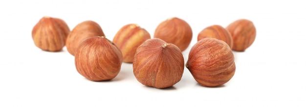 Tasty hazelnuts isolated on white.