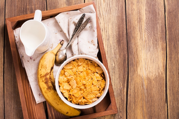 Tasty and healthy breakfast on wooden tray