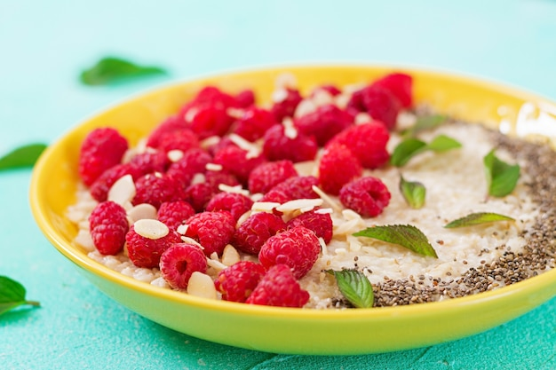 Tasty and healthy oatmeal porridge with raspberry and flax chia. healthy breakfast. fitness food. proper nutrition
