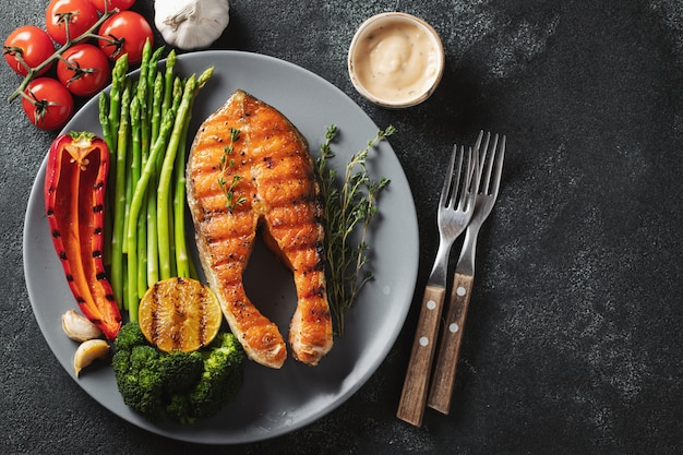 Tasty and healthy salmon steak with asparagus.