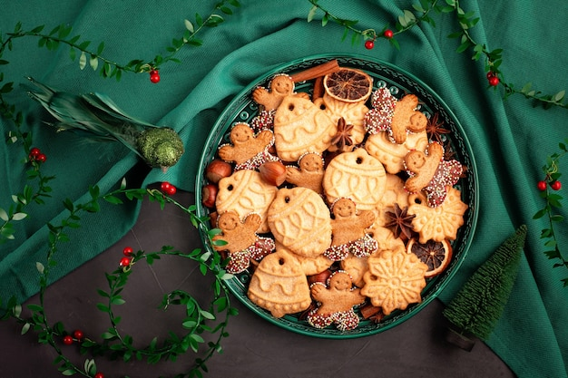 Tasty homemade christmas cookies in the green plate.