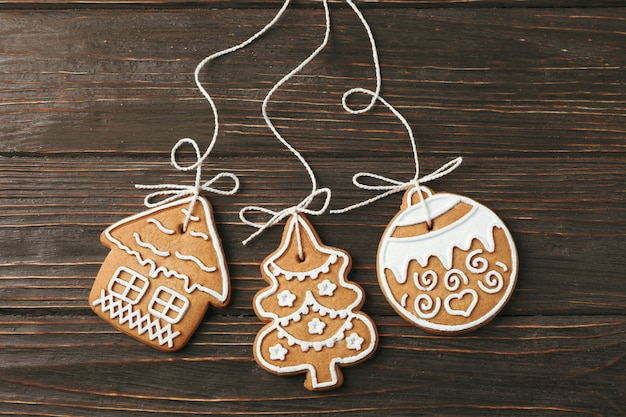 Tasty homemade christmas cookies on wooden, space for text. top view