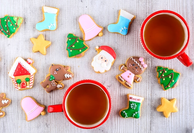 Tasty homemade decorated christmas sugar cookies on white table. top view flatlay composition