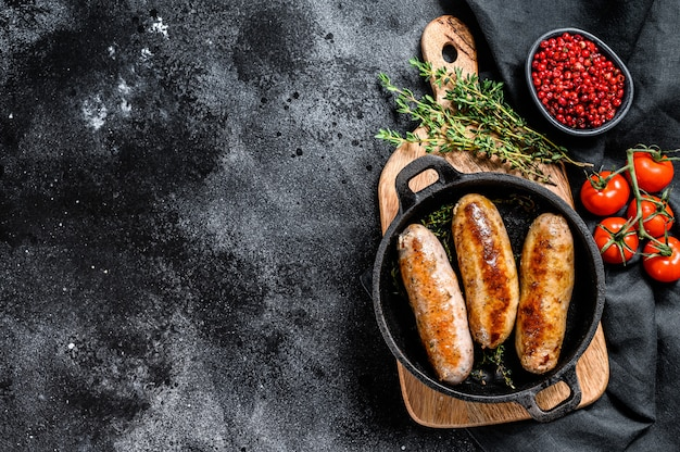 Tasty homemade sausages in a skillet