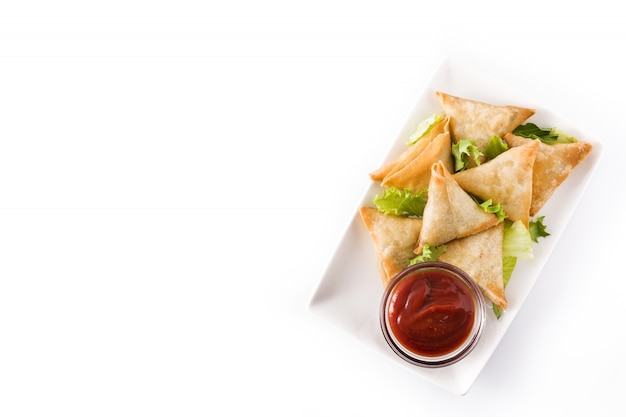 Tasty indian samosas with vegetables and sauce