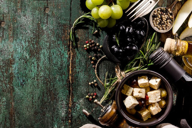 Tasty italian greek mediterranean food ingredients top view on green old rustic table above