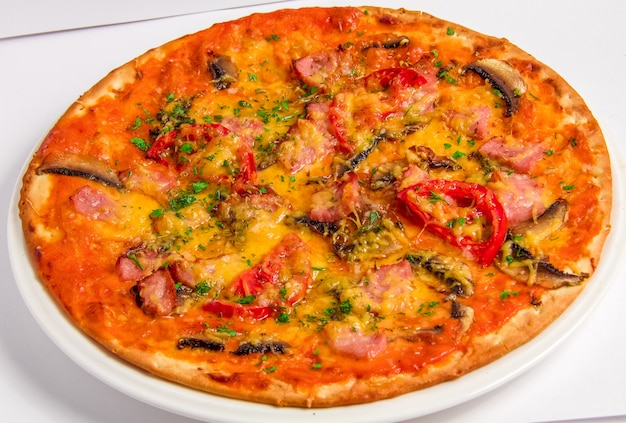 Tasty italian pizza with bacon and tomatoes