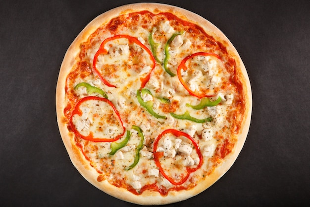 Tasty italian pizza with pepper, sweet cheese and chicken