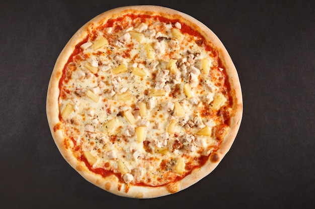 Tasty italian pizza with pineapple, chicken and cheese