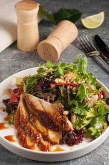 Tasty japanese cuisine  chuka seaweed and unagi smoked eel salad with nuts sauce topped with eel sauce and sesame