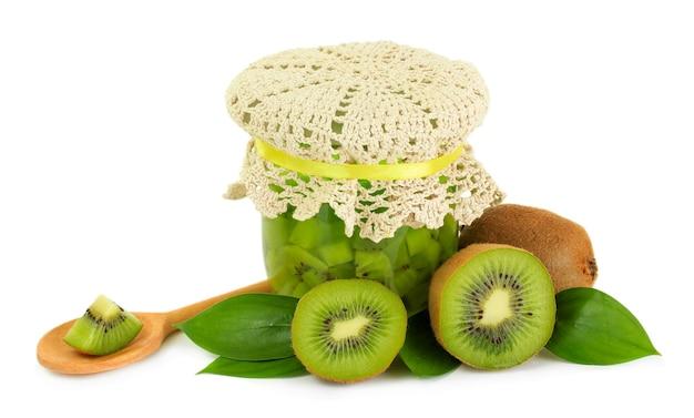 Tasty kiwi jam isolated on white