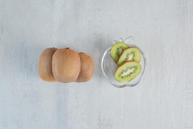 Tasty kiwi with slices on white