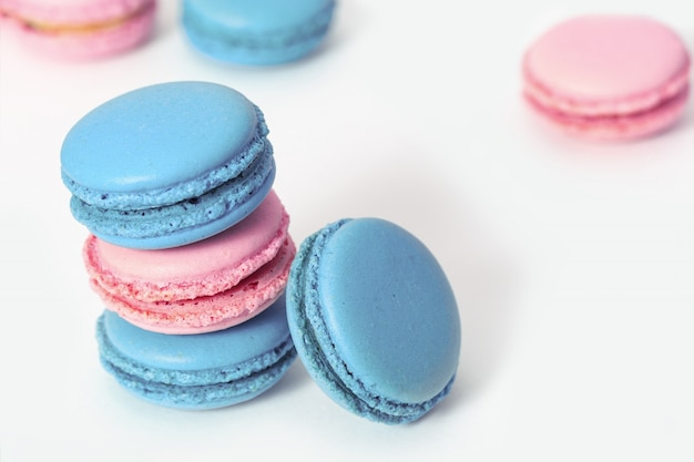 Tasty macaroons of blue and pink color close-up