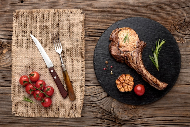 Tasty meat with sauce on wooden board