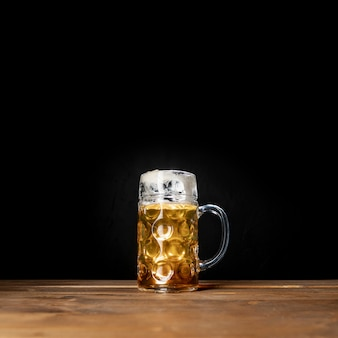 Tasty mug of bavarian beer with black background