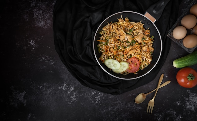 Tasty noodle in a dark background with a space for text or messages