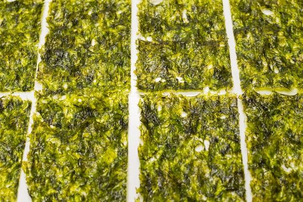 Tasty nori seaweed isolated on white