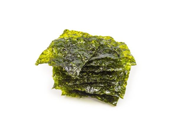Tasty nori seaweed isolated on white.
