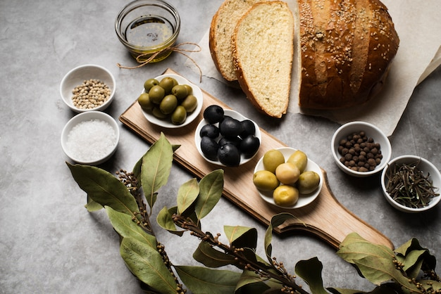 Tasty olives and bread on the table