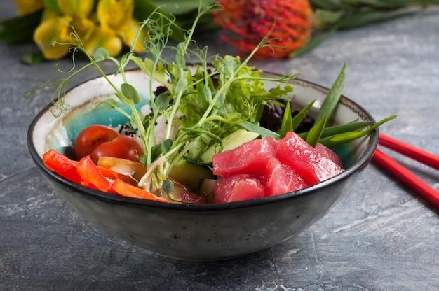 Tasty organic food poke with tuna selected focus