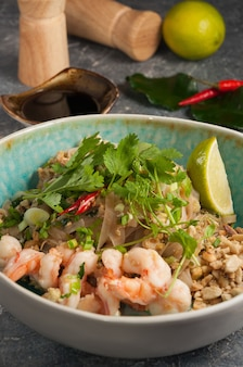 Tasty pad thai noodles with shrimp and peanuts asian cuisine
