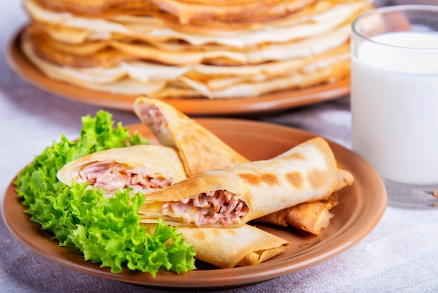 Tasty pancakes with ham and cheese. breakfast concept.