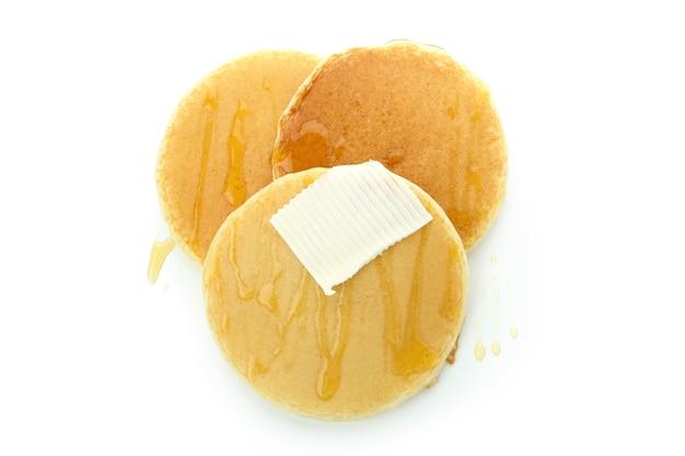 꿀, 버터 흰색 배경에 고립 된 맛있는 팬케이크