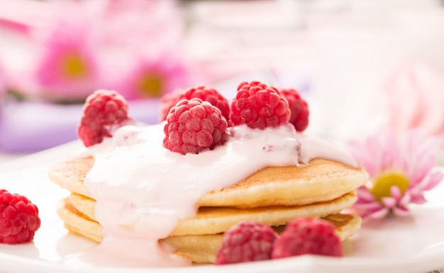 Tasty pancakes with raspberries