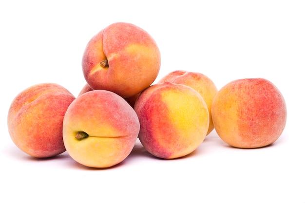 Tasty peaches on white