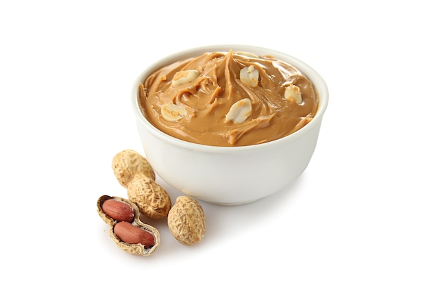 Tasty peanut butter in bowl isolated