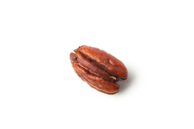 Tasty pecan nut isolated on white