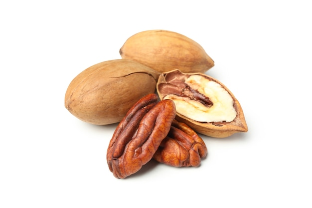 Tasty pecan nuts isolated on white