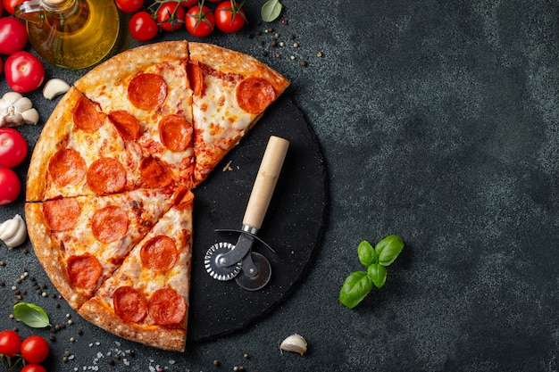 Tasty pepperoni pizza on concrete background.