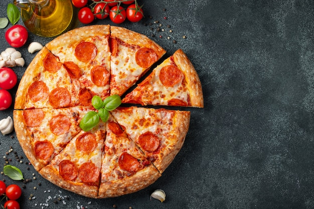 Tasty pepperoni pizza and cooking ingredients