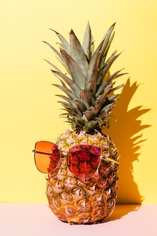 Tasty pineapple with sunglasses