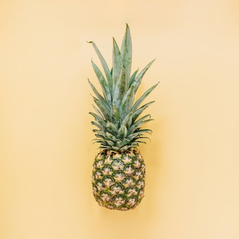 Tasty pineapple on yellow background