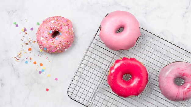Tasty pink glazed donuts